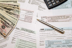 filing-federal-taxes-refund-tax-form-calculator-pen-dollar-64063104